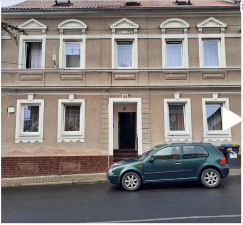 Prodej řadového domu se třemi bytovými jednotkami v obci Krupka, okres Tepliceč